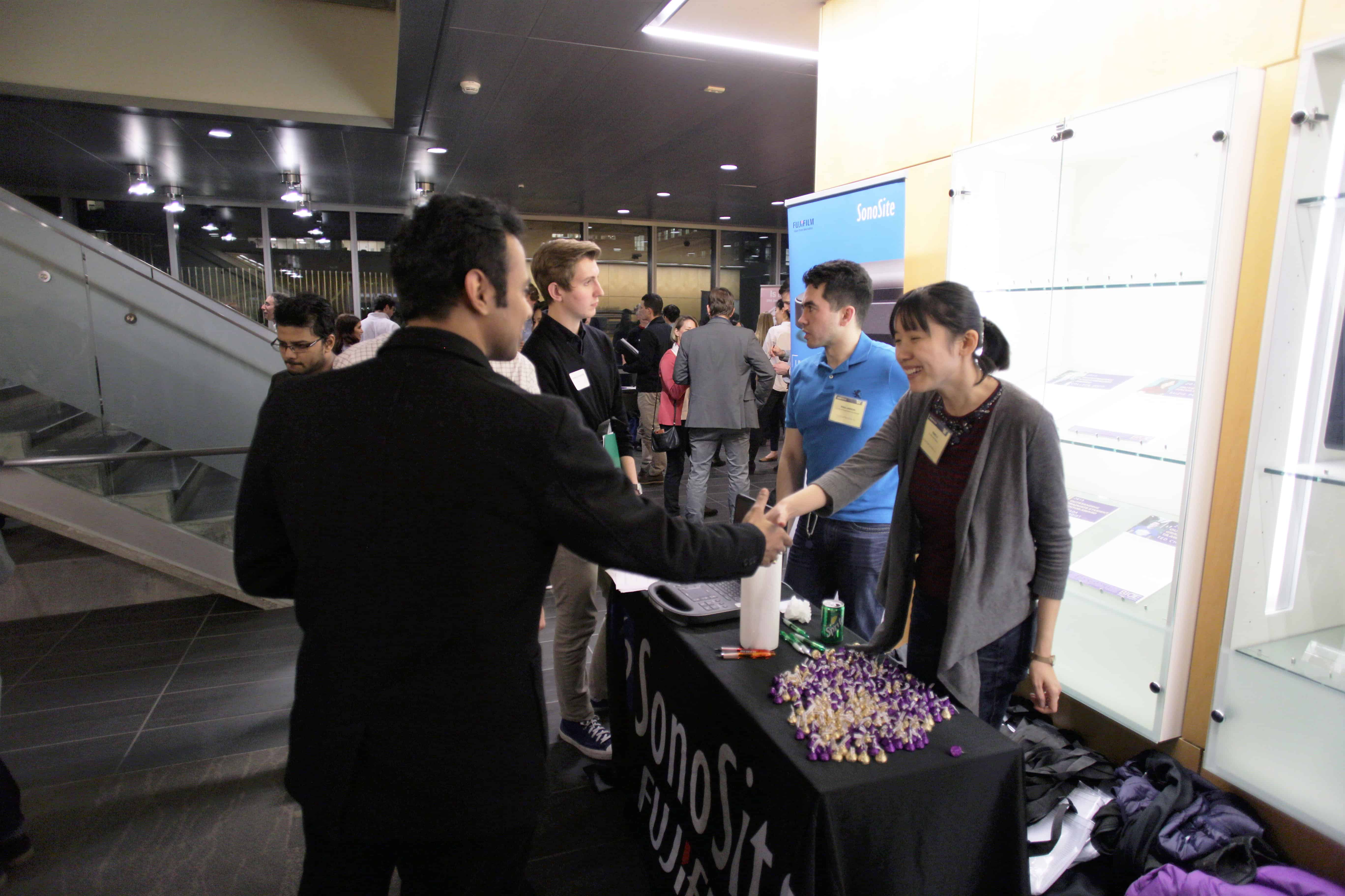 Researchers networking at an event